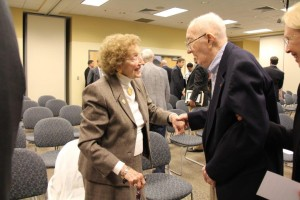 Frances Barlett-Kinne (left) speaks with the late Lt. Col. Curtis Truver at the 30th Anniversary Celebration of the Aeronautics program in 2013.