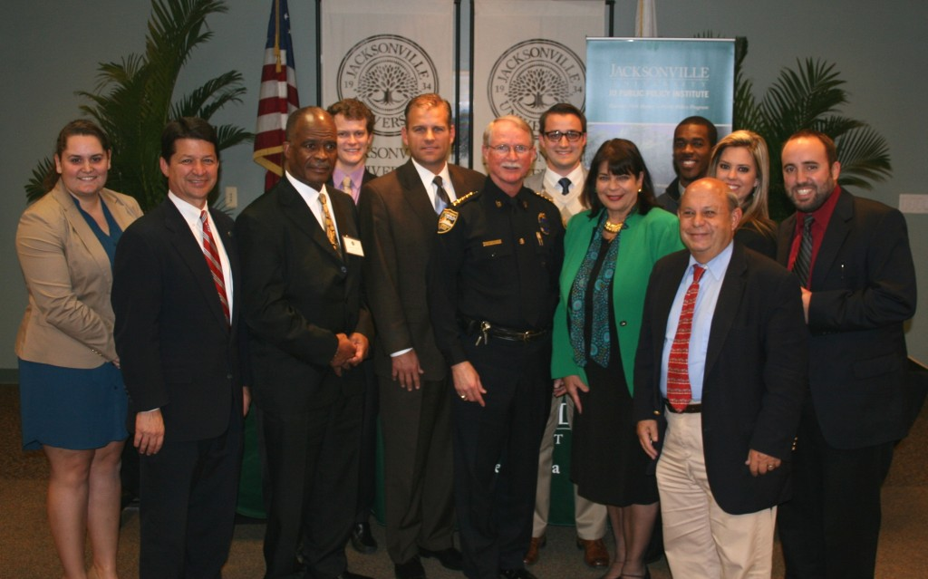 JU PPI students with officials who took part in the Institute's Nov. 20 Juvenile Justice Forum: From left, Alannah Lopes, PPI Director Rick Mullaney, Circuit Judge Henry Davis, Sean Matheny, Public Defender Matt Shirk, Jacksonville Sheriff John Rutherford, Kevin Barth, State Attorney Angela Corey, Adrian Riley, Destiny Jude, Grant Gibson and Christopher Bond. Photo by Kevin Hogencamp.