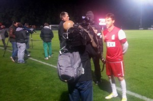 Foreign media interview the star players at the Soccer Legends Game at Southern Oak Stadium.