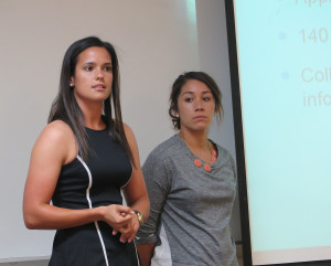 Seniors Jackie Dipiazza (left) and Sarah Sierra (right) present on the findings of the Economic Impact of the March Madness study by JU sport business students