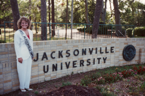 Dr. Borne with JU sign